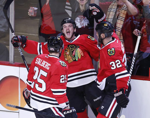 Blackhawks' Shaw celebrates his goal against the Kings with teammates Stalberg and Rozsival in the first period of Game 2 of their NHL Western Conference finals playoff hockey game in Chicago