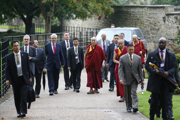 Tibetan spiritual leader, the Dalai Lama arrives for a news conference at Magdalene College in Oxford
