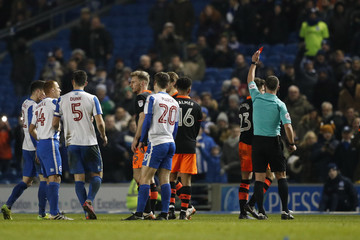 Sheffield Wednesday's Sam Hutchinson is sent off by referee Stuart Attwell