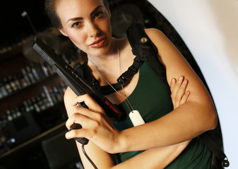 Model poses with a historic computer game pistol prior to photo shoot for the 'Nerd Dreams Calendar 2013' in Frankfurt