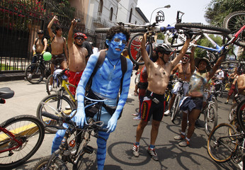 Cyclists attend a protest to demand for more bicycle paths from the city government and more respect for cyclists from motorists in Lima