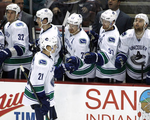 Vancouver Canucks' Raymond is congratulated for scoring against Anaheim Ducks during their NHL hockey game in Anaheim