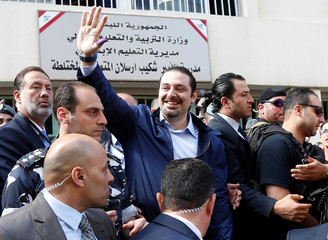 Lebanon's former Prime Minister Saad al-Hariri greets his supporters after casting his ballot at a polling station during Beirut's municipal elections
