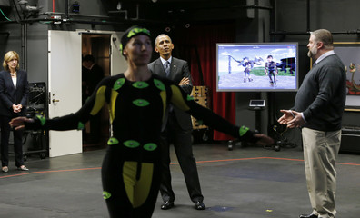 Obama watches actor play scene from 'How To Train Your Dragon 2' at Dream Works Animation studios in Glendale