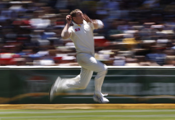 Australia's Siddle bowls to England's Trott during the third day of the fourth Ashes cricket test at the Melbourne Cricket Ground