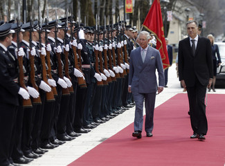 Britain's Prince Charles and Montenegrin President Vujanovic review an honour guard in Cetinje