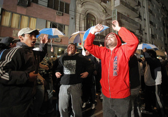 Soccer fans chant slogans in support of former Argentine coach Maradona outside of the AFA headquarters in Buenos Aires
