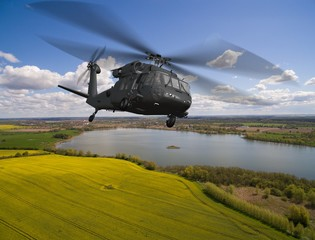 Black Hawk military Helicopter in flight - aerial view close up
