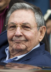 Cuban President Raul Castro reacts as he prepares to enter a car after the ALBA (Boliviarian Alternative for the Americas) summit in Caracas