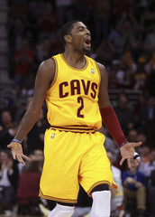 Cleveland Cavaliers Kyrie Erving reacts after hitting a three point shot during the second quarter of the Cavaliers NBA basketball game against the Los Angeles Lakers  in Cleveland