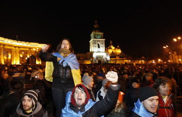 People supporting EU integration hold a rally in front of the Mikhailovsky Zlatoverkhy Cathedral in Kiev