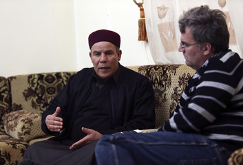 Saleh Atawich, the top Magharba tribe leader, gestures during an interview with Reuters in Benghazi