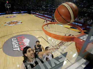 Argentina's Luis Scola leaps to the basket to score against Venezuela during their 2015 FIBA Americas Championship final basketball game in Mexico City