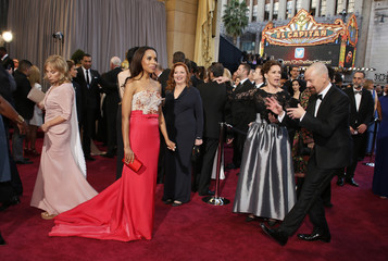 Actor Bryan Cranston (R) jokes with presenter Kerry Washington (L) on the red carpet at the 85th Academy Awards in Hollywood