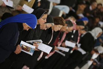 Catholic pilgrims attend mass at John the Baptist Church near the baptism site along the Jordan River