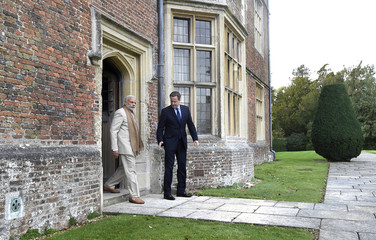 Britain's Prime Minister David Cameron walks in the garden at Chequers in Buckinghamshire with his Indian counter-part Narendra Modi, in England