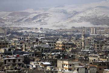 General view shows Douma covered in snow, near Damascus