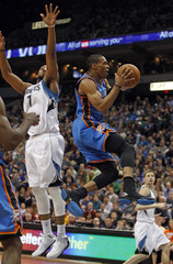 Oklahoma City Westbrook drives on a lay up past Minnesota Timberwolves Williams during their NBA game in Minneapolis