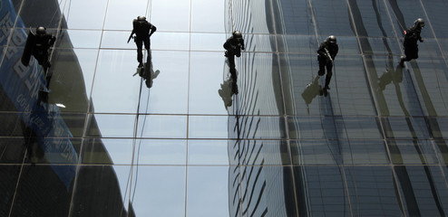 Policemen rappel down from a building at LG Electronics during an anti-terrorism and disaster drill in Seoul