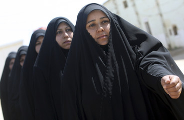 Policewomen march during a training course at a police academy in Kerbala