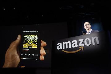 Amazon CEO Jeff Bezos shows off his company's new Fire smartphone in Seattle, Washington