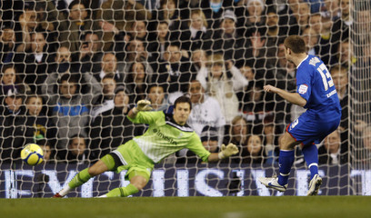 Stevenage's Joel Byrom shoots and scores from the penalty spot against Tottenham Hotspur during their English FA Cup fifth round replay soccer match at White Hart Lane