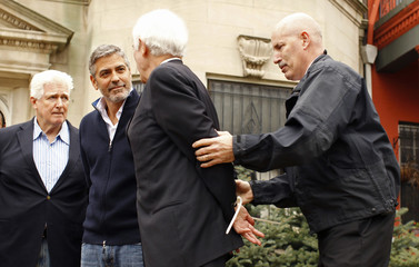 George Clooney and his father are arrested for civil disobedience after protesting at the Sudan Embassy in Washington