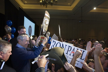 Republican presidential candidate U.S. Representative Ron Paul holds up a skateboard with his image on it, after speaking at a rally at the Green Valley Ranch Station Casino in Henderson