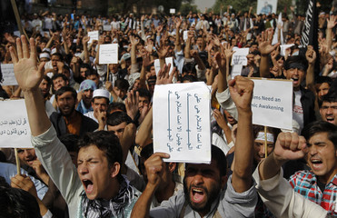 Afghan protesters shout slogans during a demonstration in Kabul