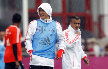 Bayern Munich's Schweinsteiger and Shaqiri arrive for team training session in Munich