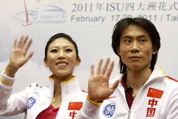 Pang Qing and Tong Jian of China wave to the cameras after performing during the pairs free skating program competition at the ISU Four Continents Figure Skating Championships in Taipei