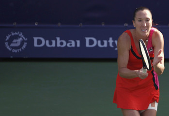 Jankovic of Serbia reacts after hitting a return to Stosur of Australia during their women's singles quarter-final match at the WTA Dubai Tennis Championships