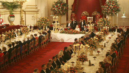 Britain's Queen Elizabeth listens to a speech by the President of Turkey, Abdullah Gul, at a state banquet in Buckingham Palace, in central London