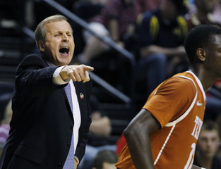 Texas' coach Rick Barnes instructs his team as they pull close to Cincinnati during the second half of their men's NCAA basketball game in Nashville, Tennessee