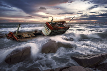 Acrylic Prints Shipwreck Wrecked boat abandoned stand on rock beach