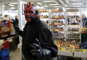 """A visitor dressed as a Star Wars character poses at the cartoon fair """"Vienna Comix"""" in Vienna"""