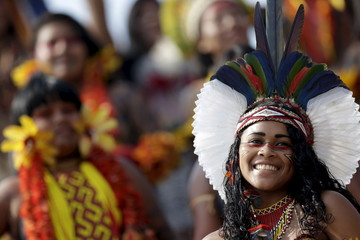 An indigenous woman from Pataxo tribe poses for photos after participating in a parade of indigenous beauty during the first World Games for Indigenous Peoples in Palmas