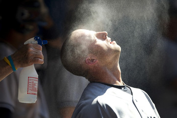 New York Yankees' Gardner is cooled off in the dugout during their American League MLB baseball game against the Toronto Blue Jays in Toronto