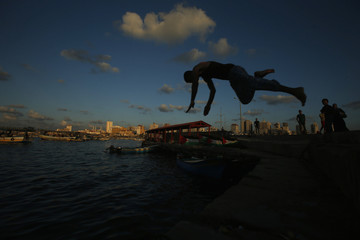 Palestinian jumps into the water at Gaza's seaport in Gaza City