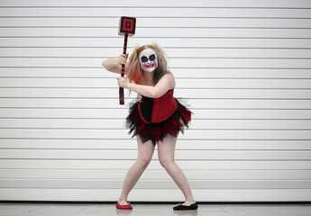 Maisy Minx dressed as Harley Quinn from the Batman comic book poses for a photograph at the London supercomic convention at the Excel centre in east London