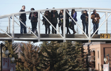 People gather on a bridge to watch for celebrities along Main Street at the Sundance Film Festival in Park City, Utah