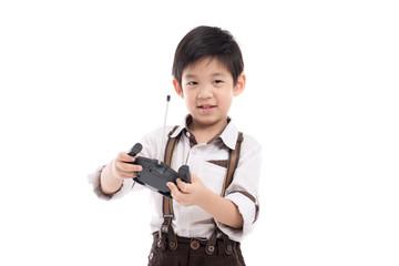 child holding radio remote control