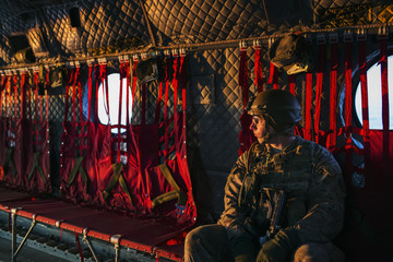 A U.S. soldier flies in a CH-47 Chinook helicopter from the 82nd Combat Aviation Brigade, to an advising mission at an Afghan National Army headquarters for the 203rd Corps in the Paktia province of Afghanistan