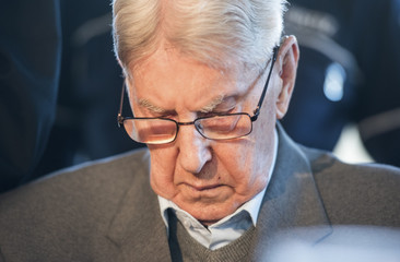 Defendant Hanning, a 94-year-old former guard at Auschwitz death camp, arrives for the continuation of his trial in Detmold