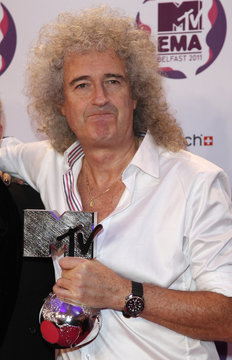 Queen guitarist Brian May holds the Global Icon award at the MTV Europe Music Awards show in Belfast