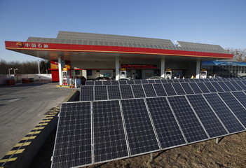 Solar panels are seen at PetroChina's solar-powered Yizhuang gas station in Beijing