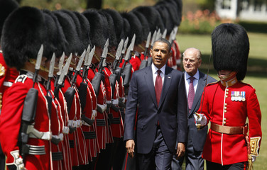 U.S. President Obama reviews an honor guard with Prince Phillip at Buckingham Palace in London