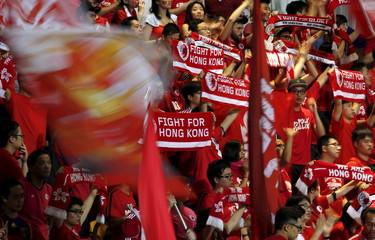 Hong Kong fans wave flags at the World Cup qualifying match between Hong Kong and the Maldives in Hong Kong