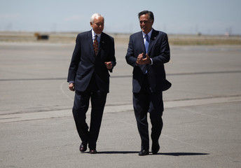 Romney is greeted by U.S. Senator Orrin Hatch in Salt Lake City