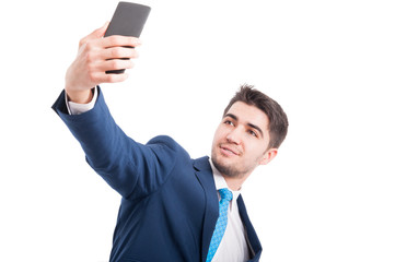 Entrepreneur taking a selfie with his modern cellphone